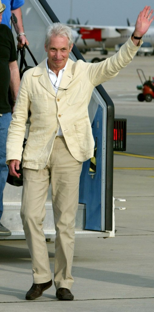 (dpa) - Charlie Watts, drummer of the British rock group Rolling Stones, arrives at the airport in Hanover, Germany, 7 August 2003. The Stones will give their last concert in Germany of the Licks world tour on 8 August in Hanover. Photo by: Rainer Jensen/picture-alliance/dpa/AP Images