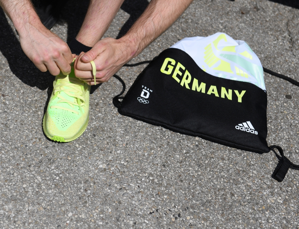 28 June 2021, Bavaria, Munich: Sport climber Jan Hojer tries on a shoe while dressing part of the German Olympic team. Photo by: Angelika Warmuth/picture-alliance/dpa/AP Images