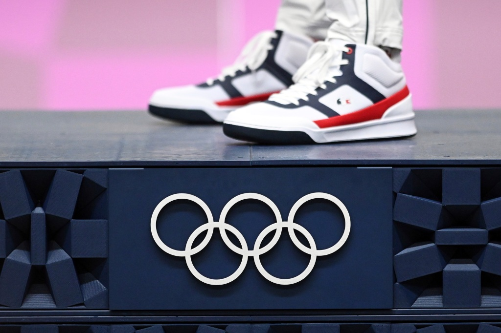 02 August 2021, Japan, Tokio: Shooting: Olympics, preliminary competition, Ol. rapid fire pistol 25 m, men, final, award ceremony, Asaka Shooting Range. The shoes of gold medallist Jean Quiquampoix from France. Photo by: Swen Pf'rtner/picture-alliance/dpa/AP Images