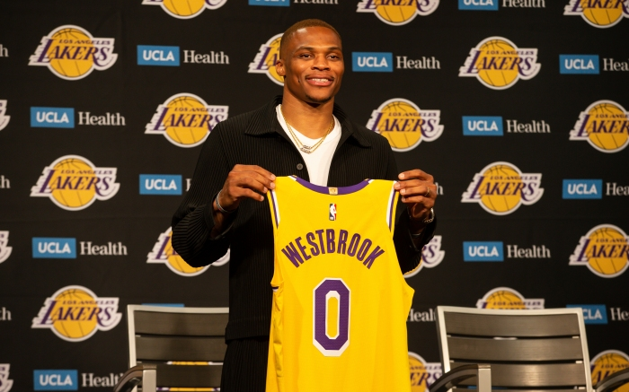 LOS ANGELES, CA - AUGUST 10: Russell Westbrook poses with 0 jersey during the Los Angeles Lakers Introductory press conference for Russell Westbrook on August 10, 2021, at Staples Center in Los Angeles, CA. (Photo by Jevone Moore/Icon Sportswire) (Icon Sportswire via AP Images)