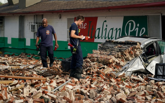 New Orleans Firefighters assess damages as they look through debris after a building collapsed from the effects of Hurricane Ida, Monday, Aug. 30, 2021, in New Orleans, La