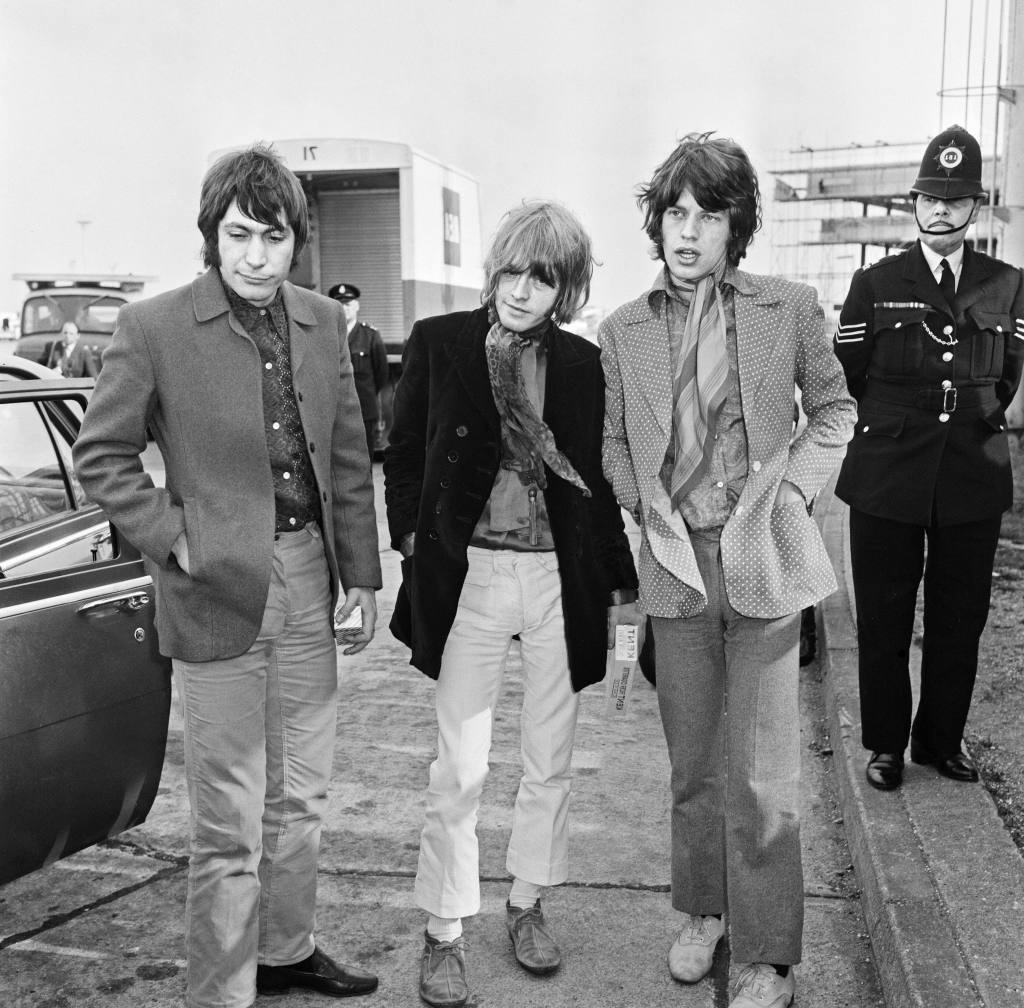 Mick Jagger, Brian Jones and Charlie Watts seen here at London Airport after their European tour ended with a huge show at the Panathinaikos stadium in Greece 18th April 1967. 18 Apr 1967 Pictured: Mick Jagger, Brian Jones and Charlie Watts seen here at London Airport after their European tour ended with a huge show at the Panathinaikos stadium in Greece 18th April 1967. Photo credit: Mirrorpix / MEGA TheMegaAgency.com +1 888 505 6342 (Mega Agency TagID: MEGA780879_001.jpg) [Photo via Mega Agency]