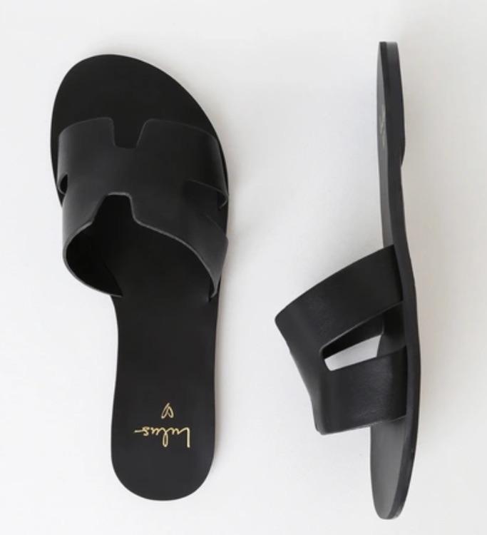 Lulu's black flat leather sandal