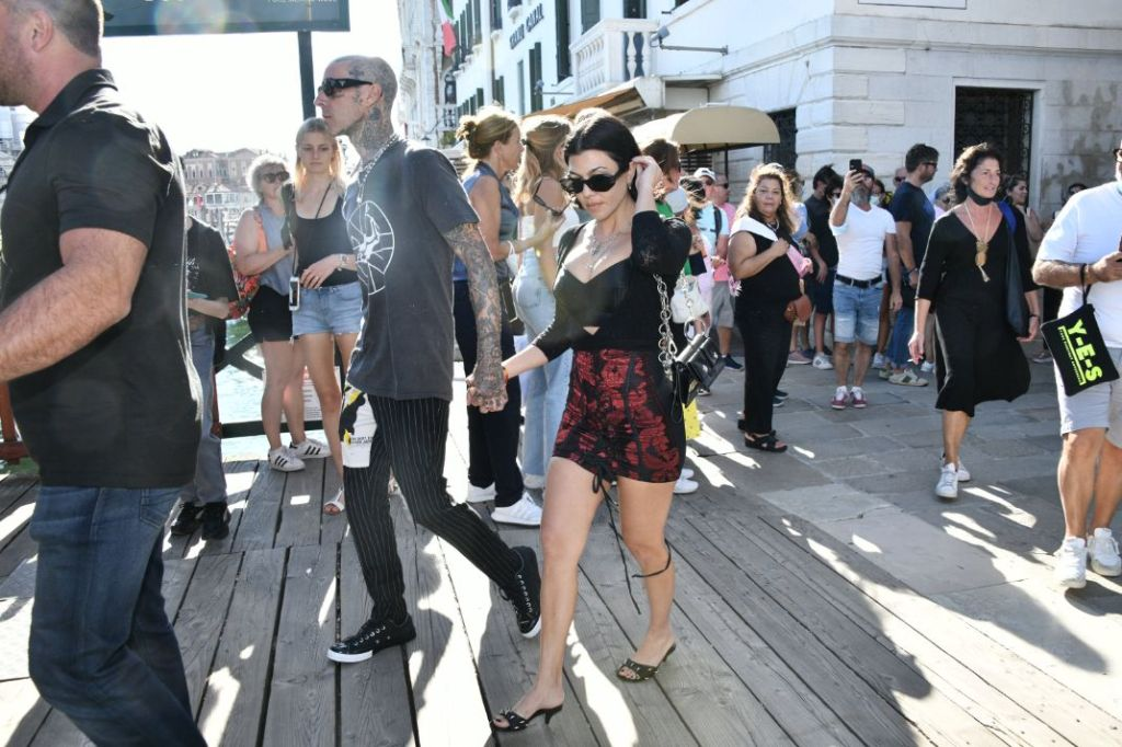 kourtney kardashian, skirt, corset, bustier, sweater, heels, studded mules, sunglasses, necklace, italy, venice, dolce and gabbana, travis barker