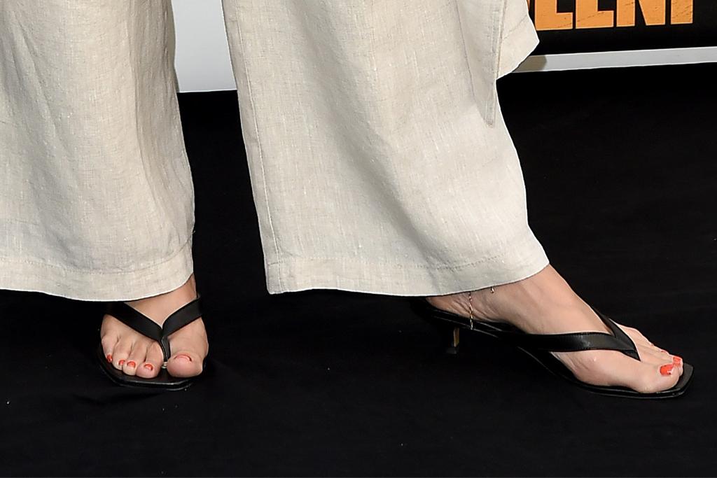 kristen bell, bodysuit, cutout bodysuit, pants, coat, trousers, thong heels, sandals, red carpet, queenpins, la