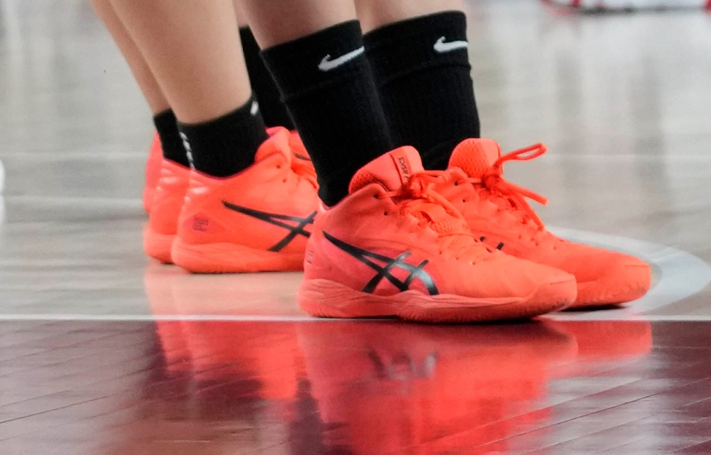 neon asics, Members of team Japan bow after their loss in the women's basketball preliminary round game against the United States of America at the 2020 Summer Olympics, Friday, July 30, 2021, in Saitama, Japan. (AP Photo/Eric Gay)