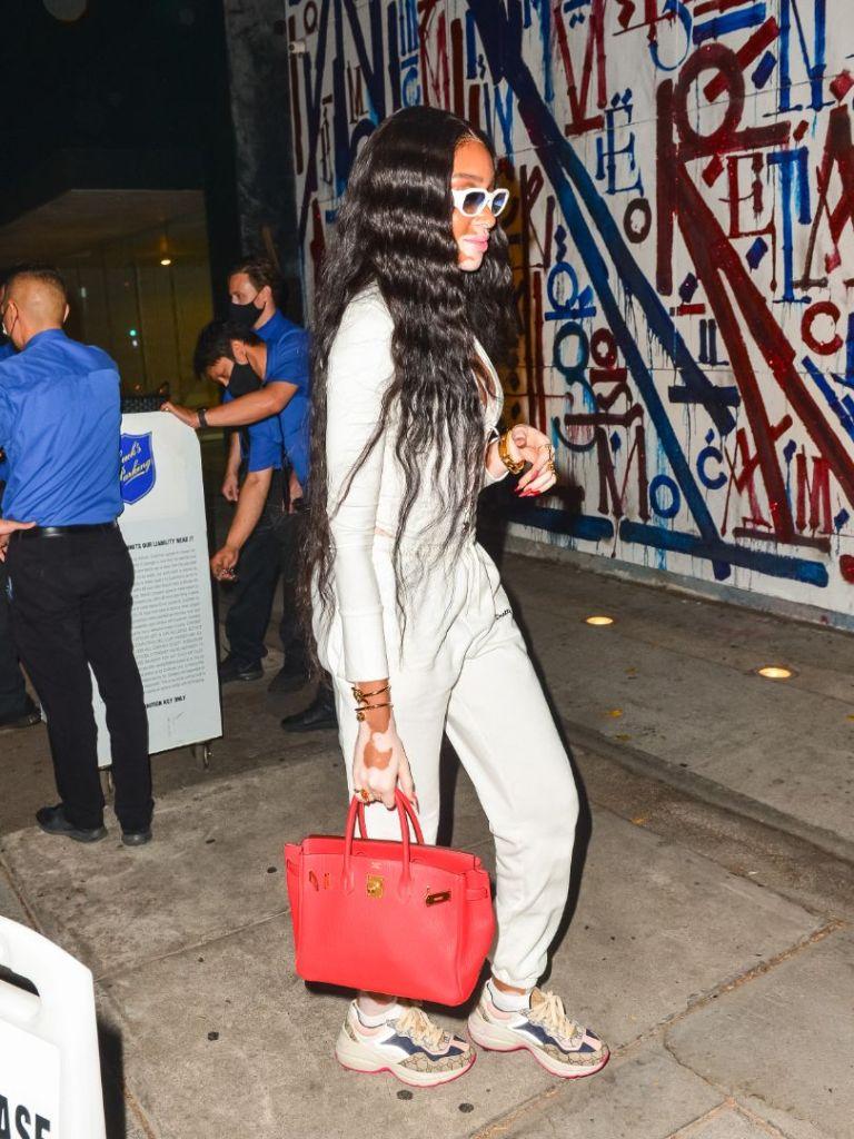 winnie harlow, bodysuit, lace-up top, sweatpants, sweats, pretty little thing, sneakers, gucci, purse, hermes, dinner, la