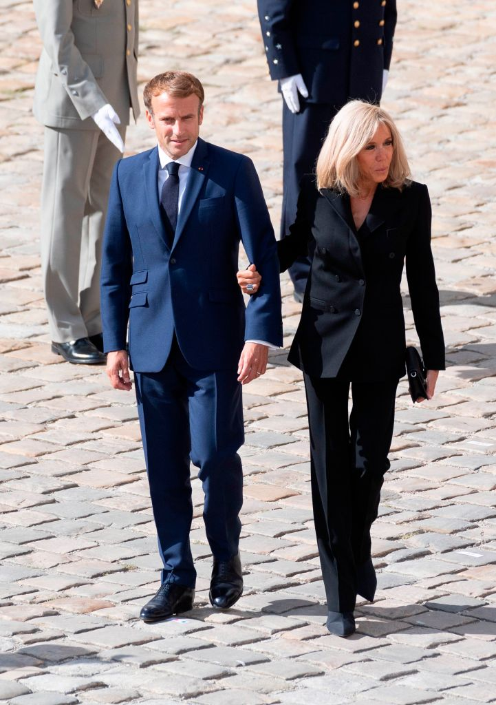 France's President Emmanuel Macron (L) and his wife Brigitte Macron at the national tribute ceremony to late French actor Jean-Paul Belmondo at the Hotel des Invalides monument in Paris on September 9, 2021. (Sipa via AP Images)