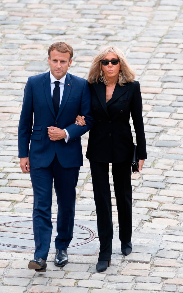France's President Emmanuel Macron (L) and his wife Brigitte Macron arrive to attend the national tribute ceremony to late French actor Jean-Paul Belmondo at the Hotel des Invalides monument in Paris on September 9, 2021. (Sipa via AP Images)