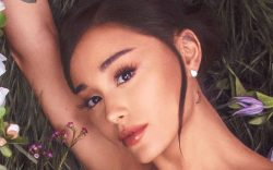 Ariana Grande poses surrounded by natural