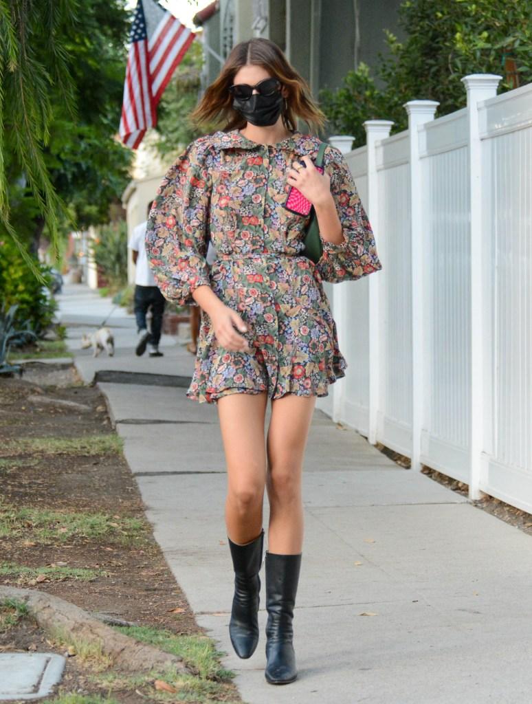 Kaia Gerber, Paco Rabanne, Celine, Doen, floral dress, black leather boots, fall fashion