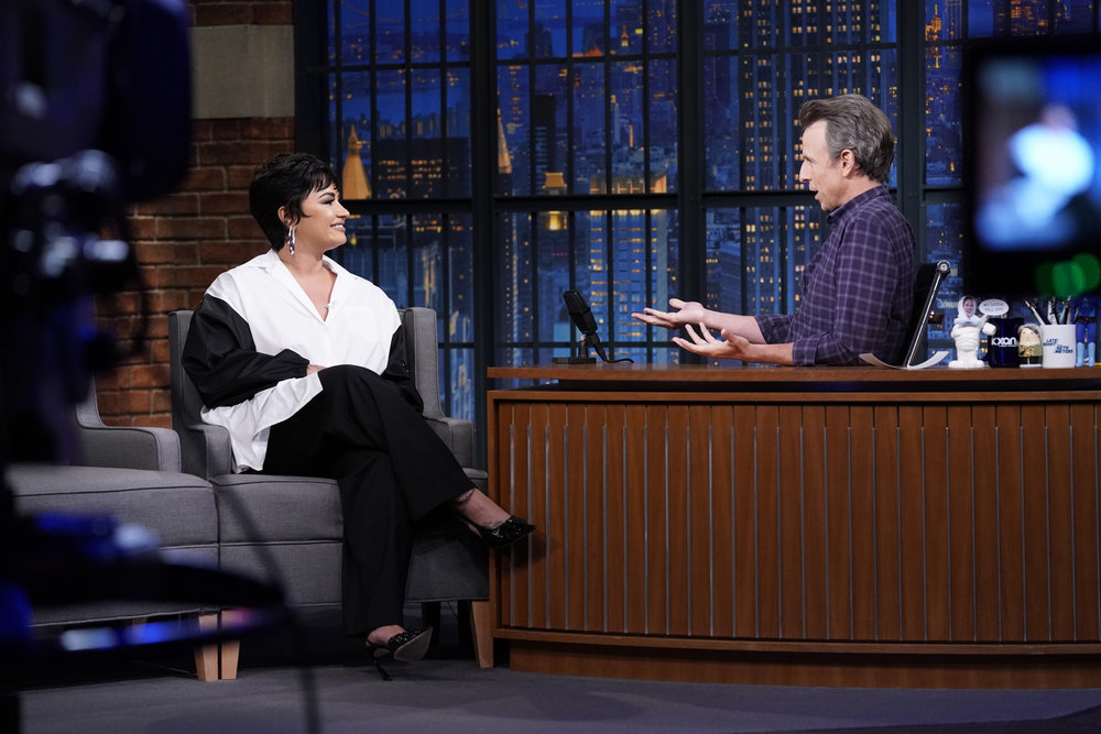 LATE NIGHT WITH SETH MEYERS -- Episode 1200A -- Pictured: (l-r) Singer Demi Lovato during an interview with host Seth Meyers on September 29, 2021 -- (Photo by: Lloyd Bishop/NBC)