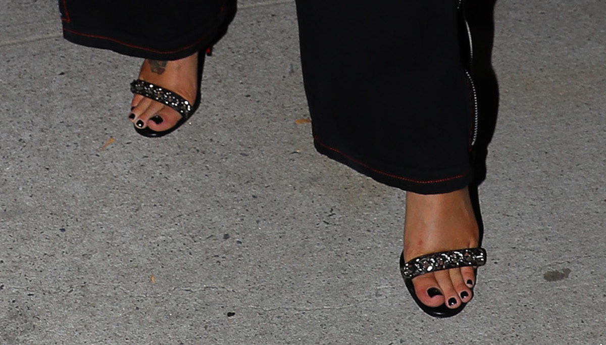 Halsey seen posing while leaving spring studios in New York City, giuseppe zanotti sandals with chain link detail