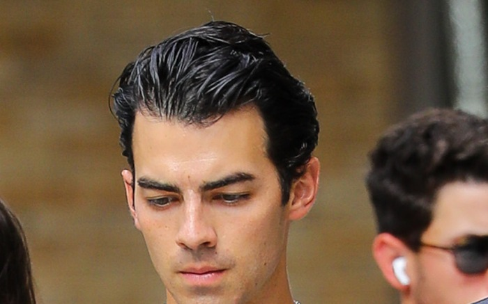 Joe Jonas Shows Off His Bulging Biceps While Walking Around With A Group Of Pals
