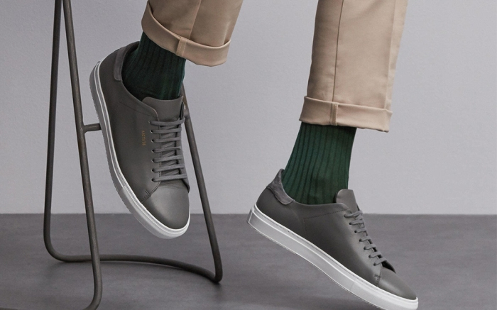 Man wearing London Sock Company socks with leather sneakers and cuffed chino pants