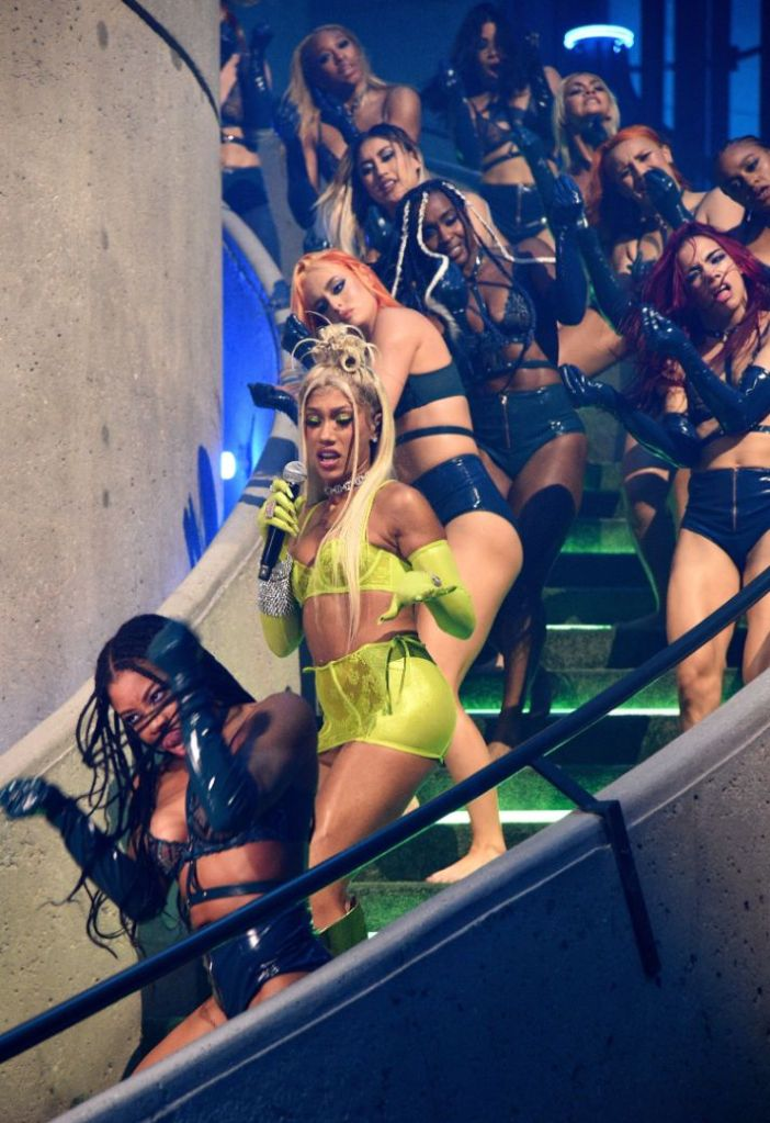 bia, bralette, yellow, skirt, gloves, thong, lace, green boots, knee-high boots, savage x fenty, show, volume 3, amazon, performance