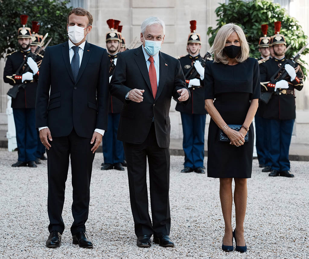 France's President Emmanuel Macron, left, and his wife Brigitte Macron, right, welcome Chile's President Sebastian Pinera, prior to a meeting at the Elysee Palace, in Paris, Monday, Sept. 6, 2021. (AP Photo/Thibault Camus)