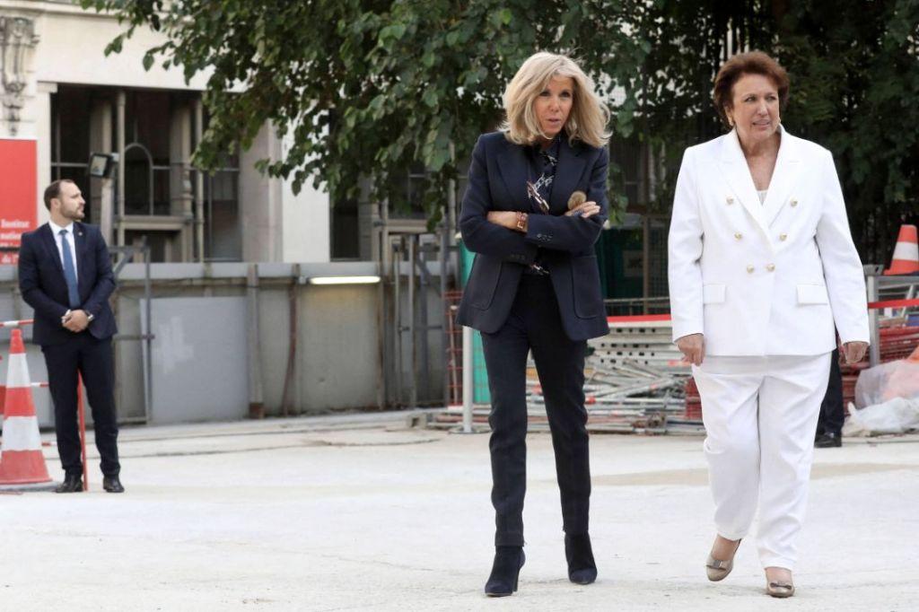 brigitte macron, blazer, blouse, pants,skinny jeans, boots, booties, library, emmanuel macron