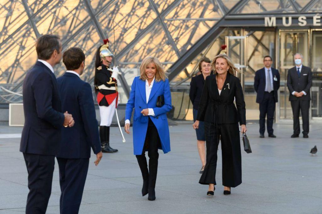 brigitte macron, blue coat, white blouse, trousers, pants, boots, booties, louis vuitton, paris, louvre, museum, greek prime minister