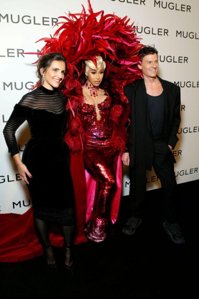 cardi b, feather dress, red dress, sheer skirt, corset, mugler, gown, pants, heels, post baby body, paris, exhibit