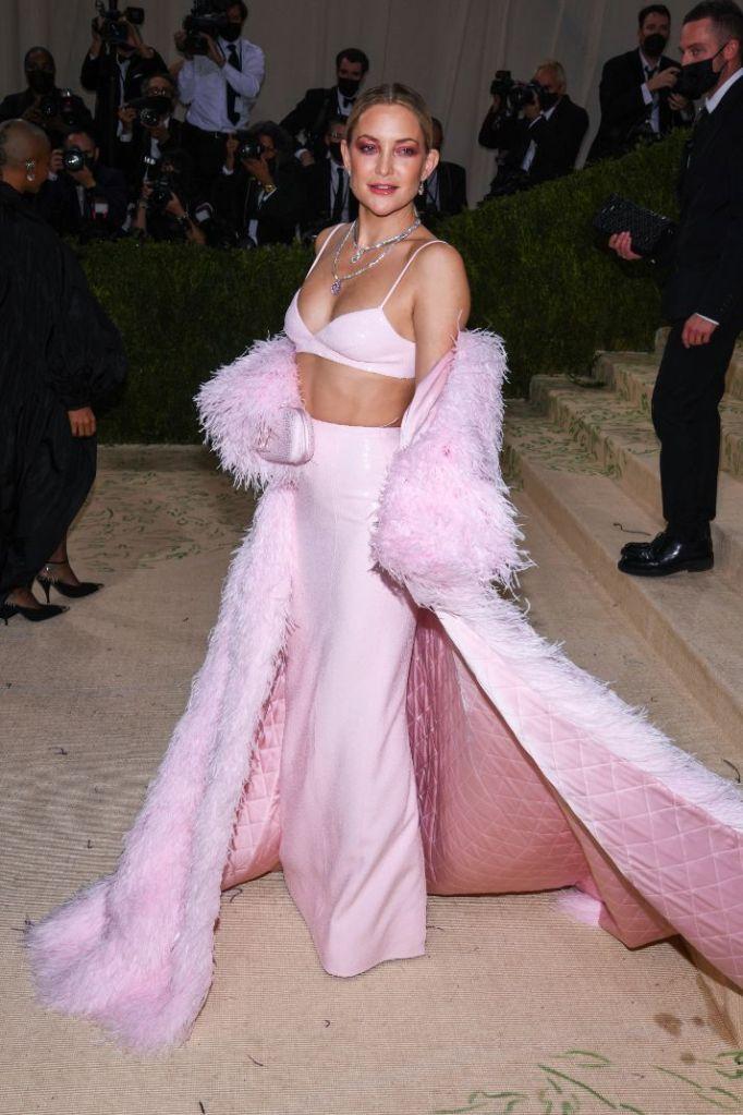 kate hudson, pink skirt, bralette, fur coat, heels, platforms, michael kors, met gala, 2021