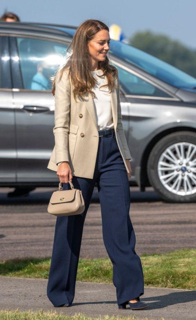 kate middleton, blouse, blazer, heels, pants, pumps, navy heels, purse, afghanistan, oxfordshire, emmy london