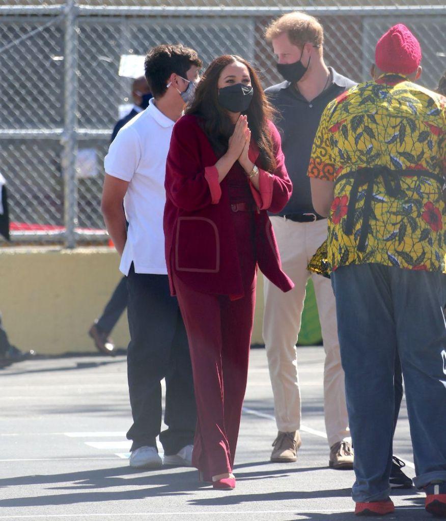 meghan markle, red coat, shirt, red pants, heels, red heels, pumps, school, harlem, new york, prince harry