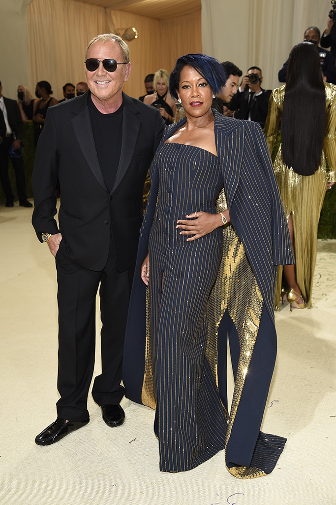 """Michael Kors, left, and Regina King attend The Metropolitan Museum of Art's Costume Institute benefit gala celebrating the opening of the """"In America: A Lexicon of Fashion"""" exhibition on Monday, Sept. 13, 2021, in New York. (Photo by Evan Agostini/Invision/AP)"""