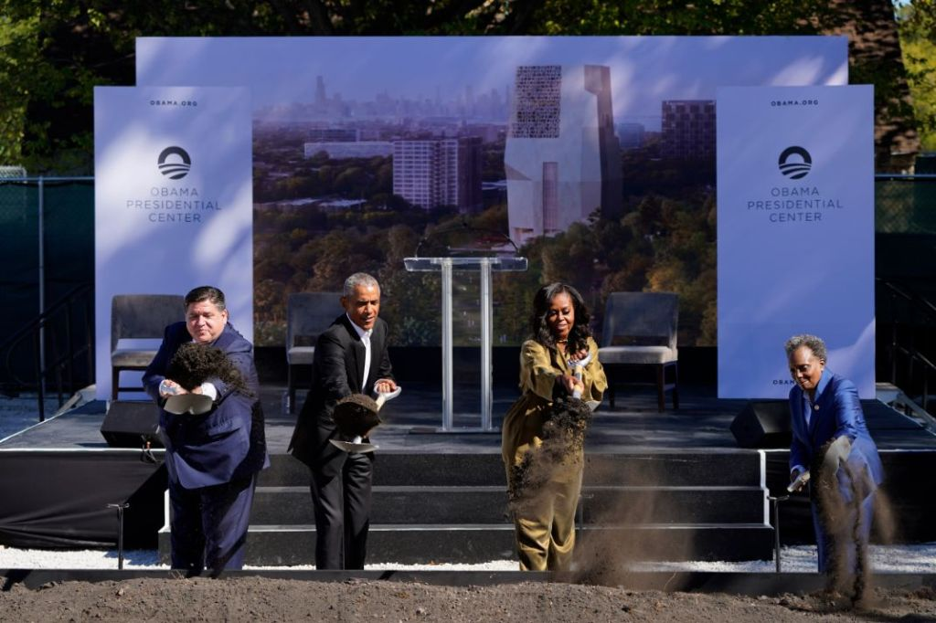 michelle obama, jumpsuit, heels, necklace, green outfit, library, chicago, president obama, barack obama, groundbreaking