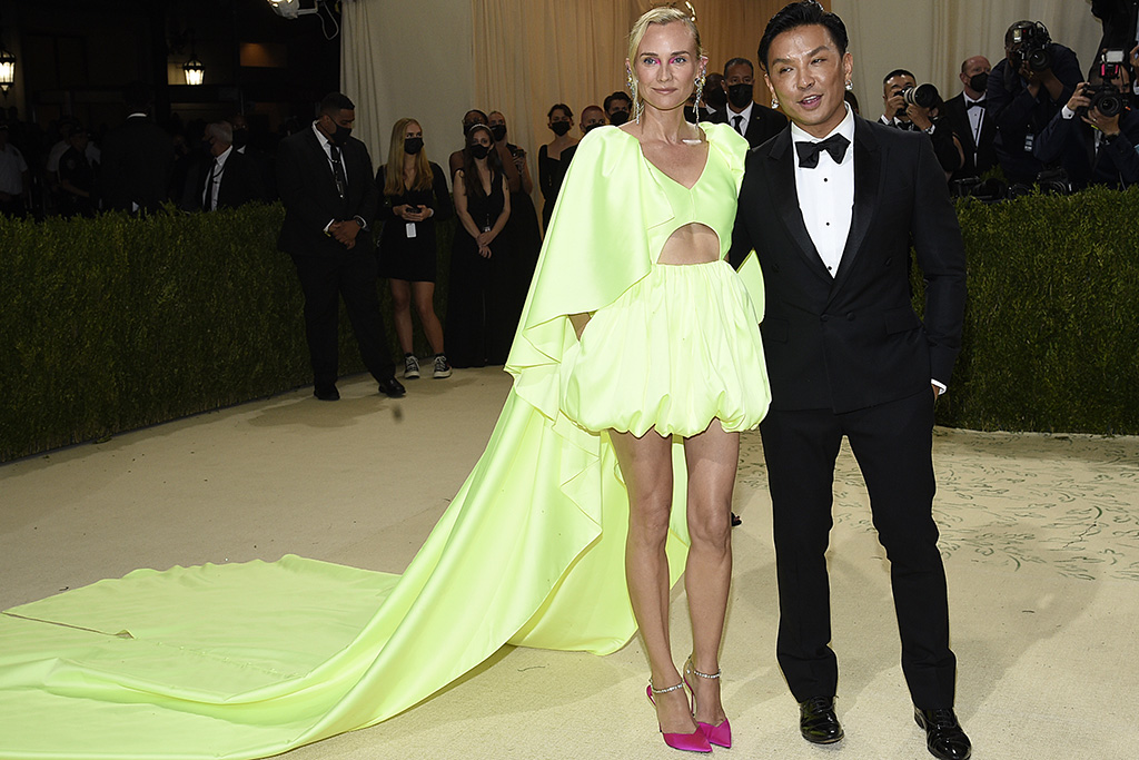 """Diane Kruger, left, and Prabal Gurung attend The Metropolitan Museum of Art's Costume Institute benefit gala celebrating the opening of the """"In America: A Lexicon of Fashion"""" exhibition on Monday, Sept. 13, 2021, in New York. (Photo by Evan Agostini/Invision/AP)"""