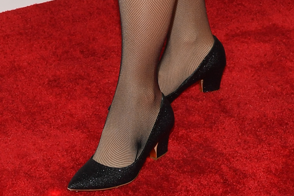 rebel wilson, plunging dress, glittering dress, sheer tights, heels, pumps, red carpet, academy museum of motion pictures, la