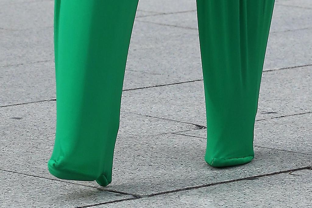 Cardi B, Paris Fashion Week, pleated pants, heeled pants, bonnet, sunglasses, green