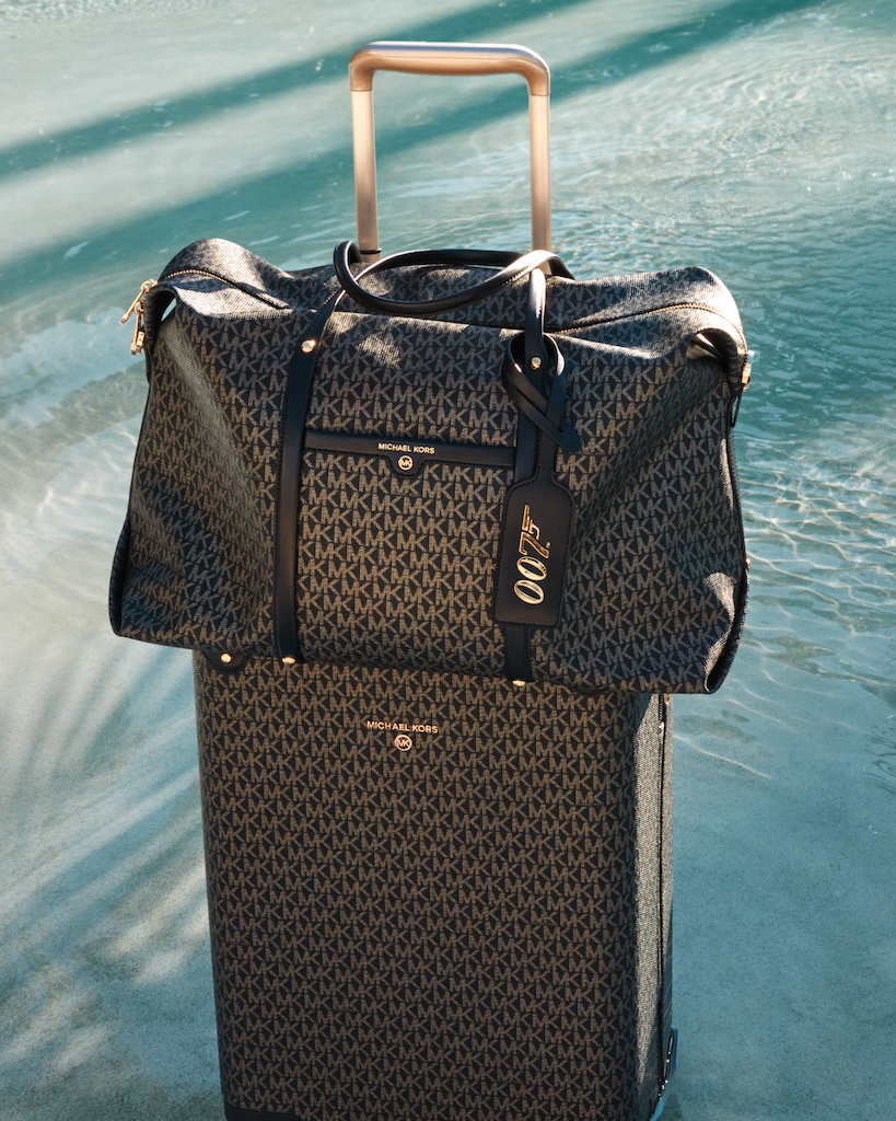 The luggage a part of the Michael Kors x 007 collection.