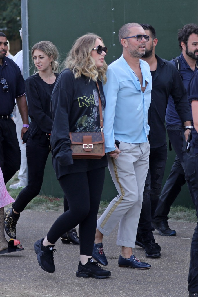 Adele, sneakers, black sneakers, chunky sneakers, Louis Vuitton, Valentino, sunglasses, crossbody bag, Celine Dion, concert, style, style evolution