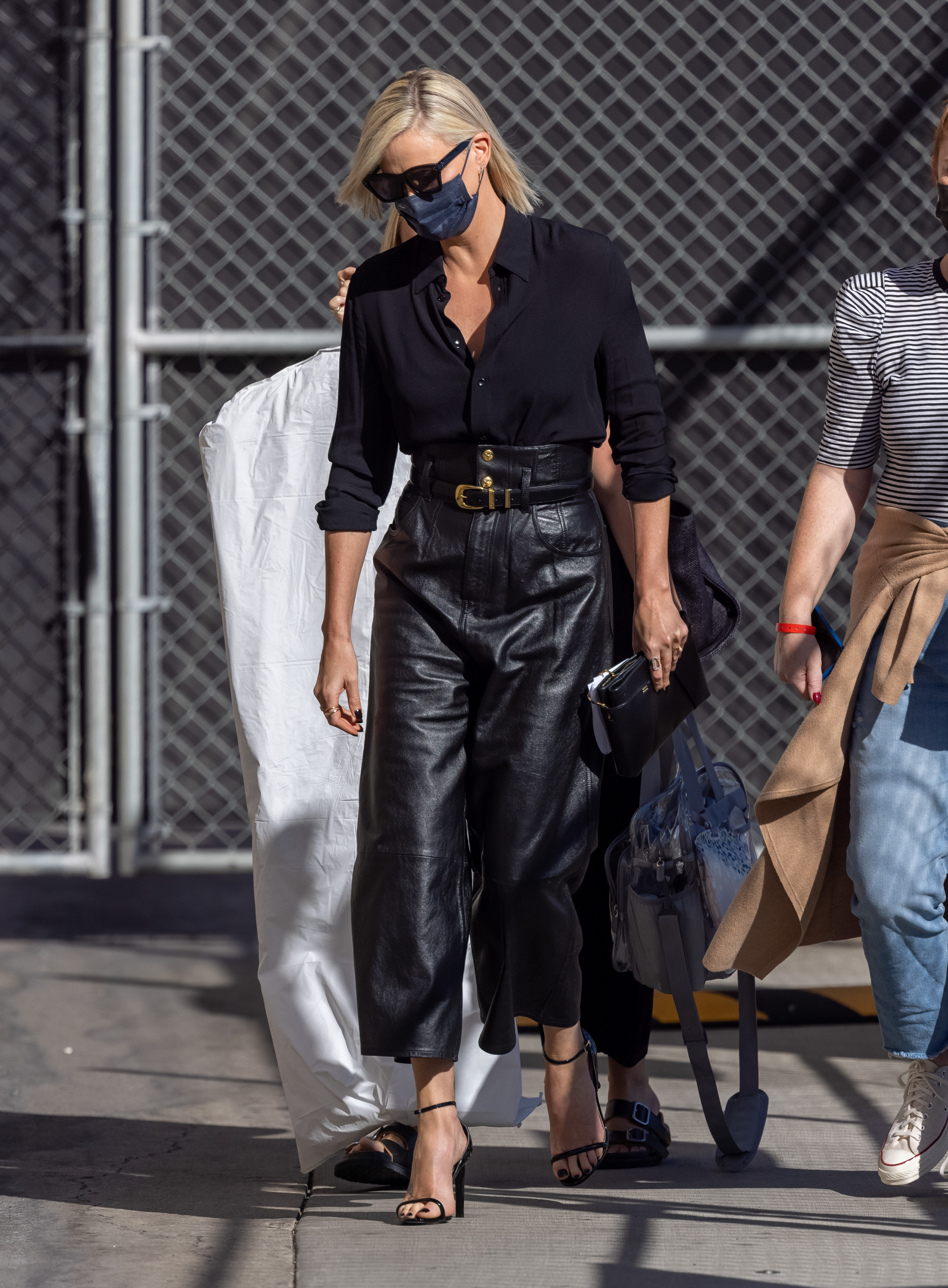 """Charlize Theron is seen at """"Jimmy Kimmel Live"""" in Los Angeles, California. 30 Sep 2021 Pictured: Charlize Theron. Photo credit: RB/Bauergriffin.com / MEGA TheMegaAgency.com +1 888 505 6342 (Mega Agency TagID: MEGA792371_001.jpg) [Photo via Mega Agency]"""