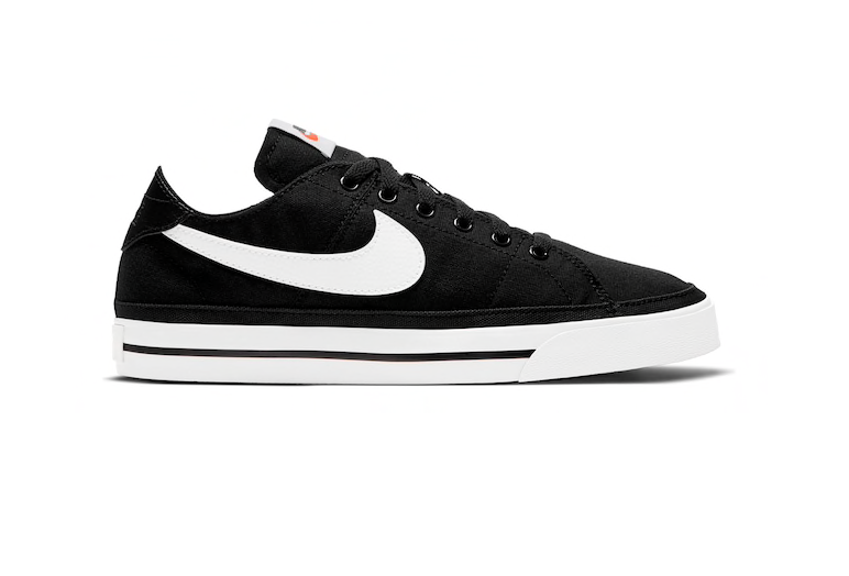 Black canvas sneakers with white soles and swoosh