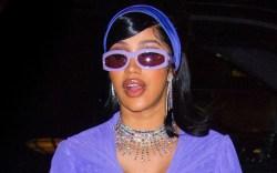 cardi b, purple catsuit, hat, sunglasses,