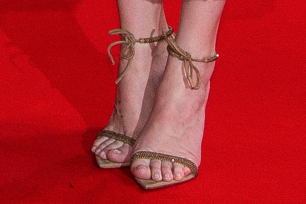 dakota johnson, feather dress, mesh dress, gucci, heels, sandals, red carpet, london, lost daughter, bfi
