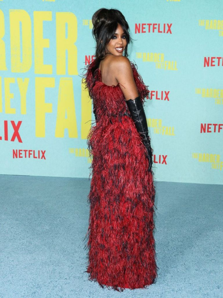 kelly rowland, gown, feather dress, red dress, leather gloves, heels, black, sandals, la, harder they fall, red carpet