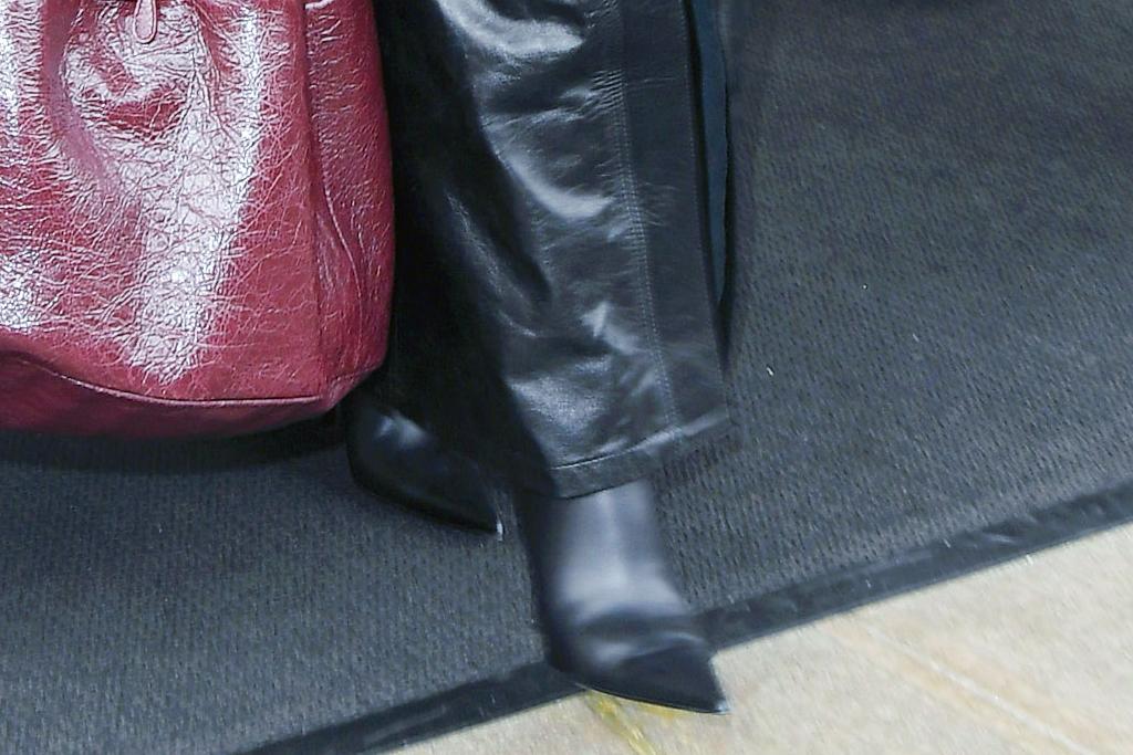 kim kardashian, puffer, coat, leather pants, shirt, leather boots, black outfit, heels, hat, balenciaga, new york, snl, hotel