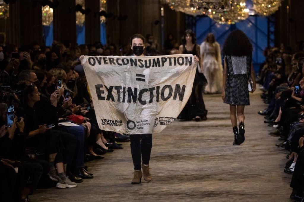 louis vuitton, protestor, paris fashion week