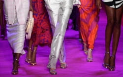 Model Gigi Hadid, center, and her