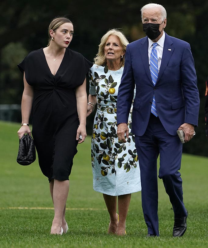 President Joe Biden, first lady Jill Biden, and granddaughter Naomi Biden, walk across the South Lawn of the White House in Washington, Monday, Oct. 11, 2021, after returning on Marine One from a weekend in Wilmington, Delaware. (AP Photo/Susan Walsh)