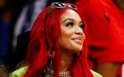 saweetie, red hair, green bralette, jacket,