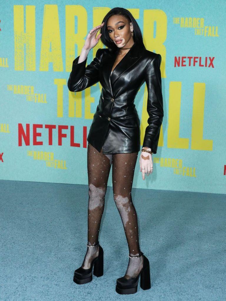 winnie harlow, leather dress, minidress, little black dress, sheer tights, heels, platforms, red carpet, harder they fall, la